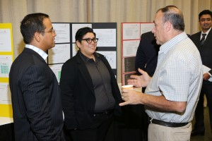 Joe Cusimano (right), an RTC Lab Industry mentor discusses a project with ITM student Cruz Tovar (middle).
