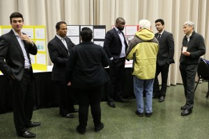 Attendees interact with Real-Time Communications students during the poster session.